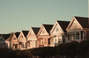 Row of houses against blue sky